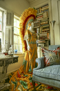 The mannequin dressed in full Mardi Gras costume is one of her favorite conversation pieces.