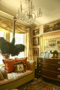 One of Loftin's accessory rooms features a 4-foot stuffed ostrich she had previously installed in the Cathedral Antiques Show House and an antique carriage rendering said to depict transportation designed for the Pope.