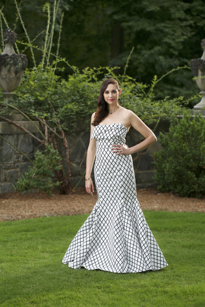 Wardrobe: Dress (Carolina Herrera, $3,990), Neiman Marcus; jewelry (necklace and earrings) Kendra Scott; bracelet her own