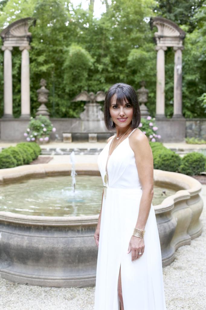 Wardrobe: Dress (Faviana International Inc., $295), Neiman Marcus; jewelry (necklaces, earrings and bracelet), Kendra Scott; rings her own