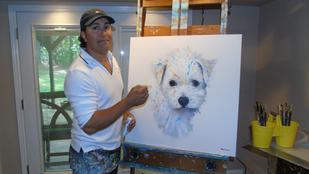 Artist Aziz Kadmiri works on a pet painting in the company's Woodstock studio.