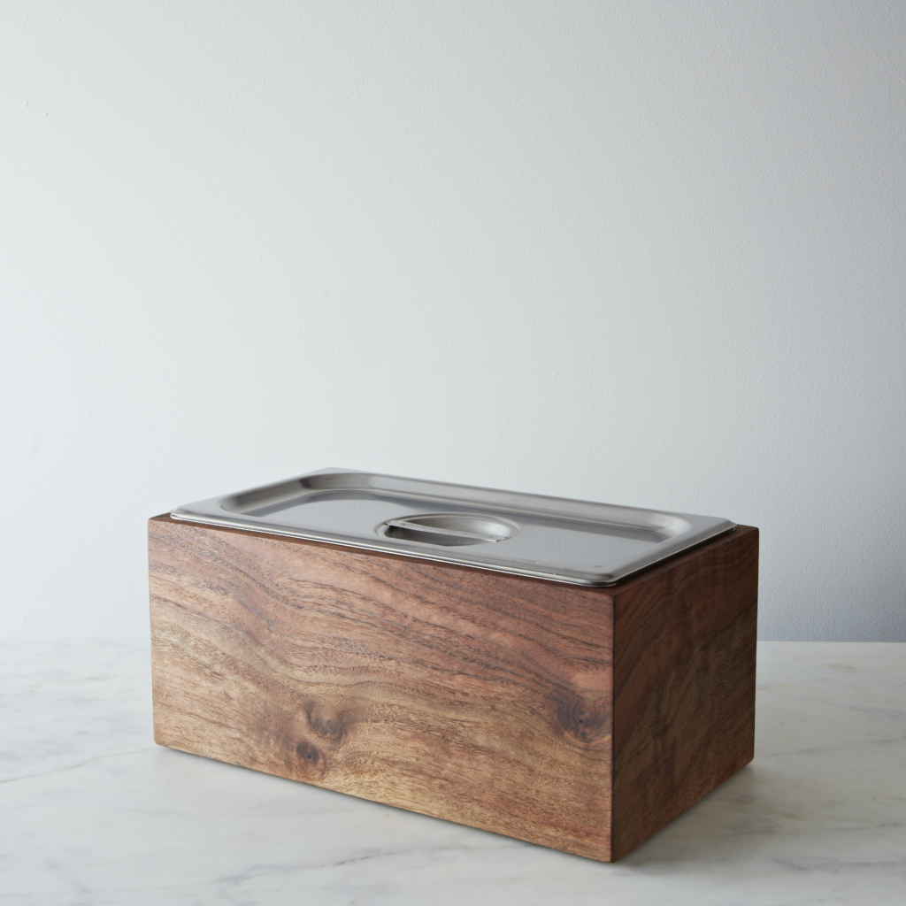 Salvaged offcuts of walnut wood from Cliff Spencer Furniture Maker are crafted into this Noaway Countertop Compost Bin, which is meant to save your kitchen scraps for transporting into the compost pile. Available for $150 at farmstarlivingshop.com.