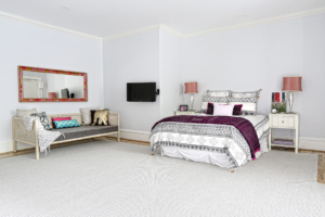 With more than enough room for a slumber party, Hazel's day-lit master bedroom has two comfy lounging beds covered in fun pillows from Anthropologie, Target, Nadeau and Duralee.