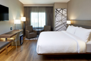 The hotel's sleek rooms have a clutter-free design centered around comfy beds with fluffy duvets.