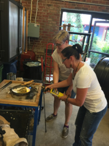 The author creating her vase at The Olio Glassblowing Studio.