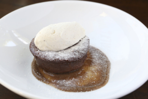 Desserts are soul-satisfying. Pictured here: the Chocolate Nemesis with Brandy cream, a nectarine coulis and malt dust.