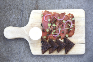 Like the lightest version of a deli sandwich, the salmon pastrami is a great start to a meal.