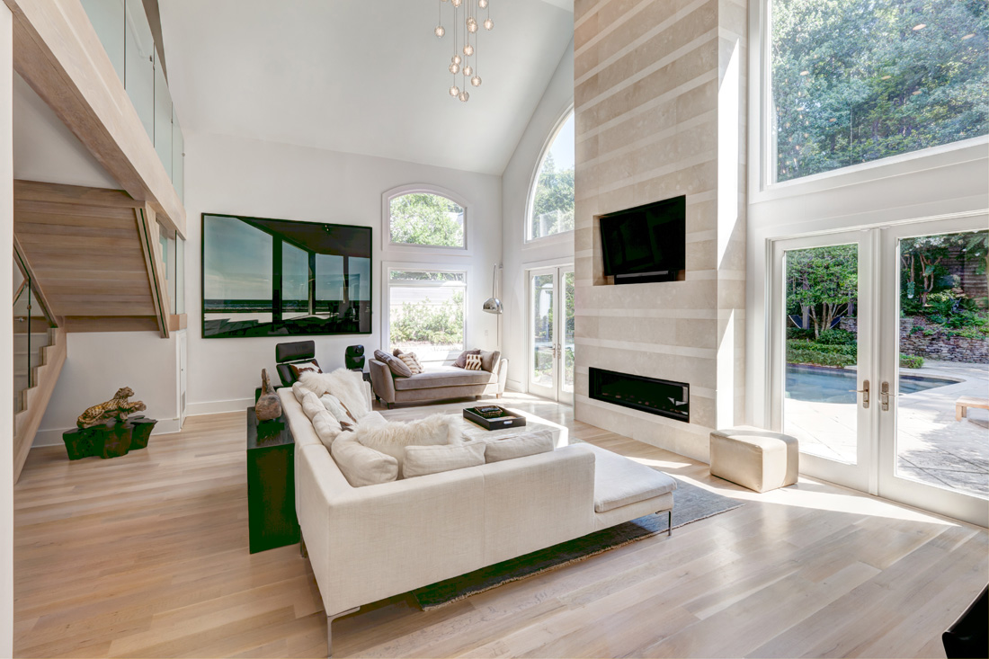 The clean palette of the family room allows the natural light to highlight the space.