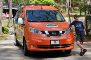 Nature boy: The writer's nephew Pearce poses alongside the Scamper Van before setting off on his camping adventure.