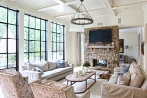 The living room is filled with sunlight, thanks to the floor-to-ceiling iron windows the family added in a recent renovation.
