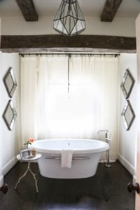 The envy worthy master bathroom mixes rustic and modern elements.