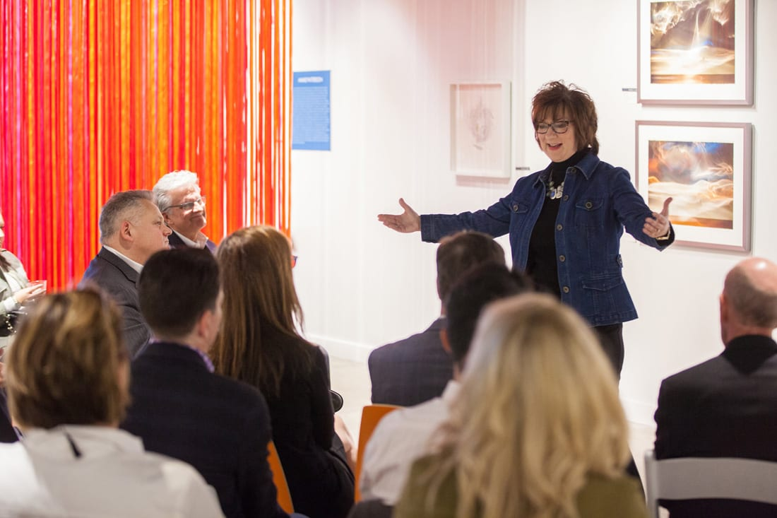 Corporate leadership advisor Amy Balog speaks at a recent gathering of art and spoken word enthusiasts at the Anne O Art gallery.
