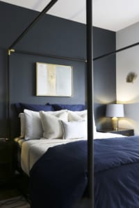Upstairs, the master bedroom's masculine decor matches the homeowners' aesthetics to a T.