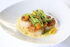 Haven's succulent, seared Georges Bank scallops are served on a bed of sweet creamed corn. Mouth watering yet?