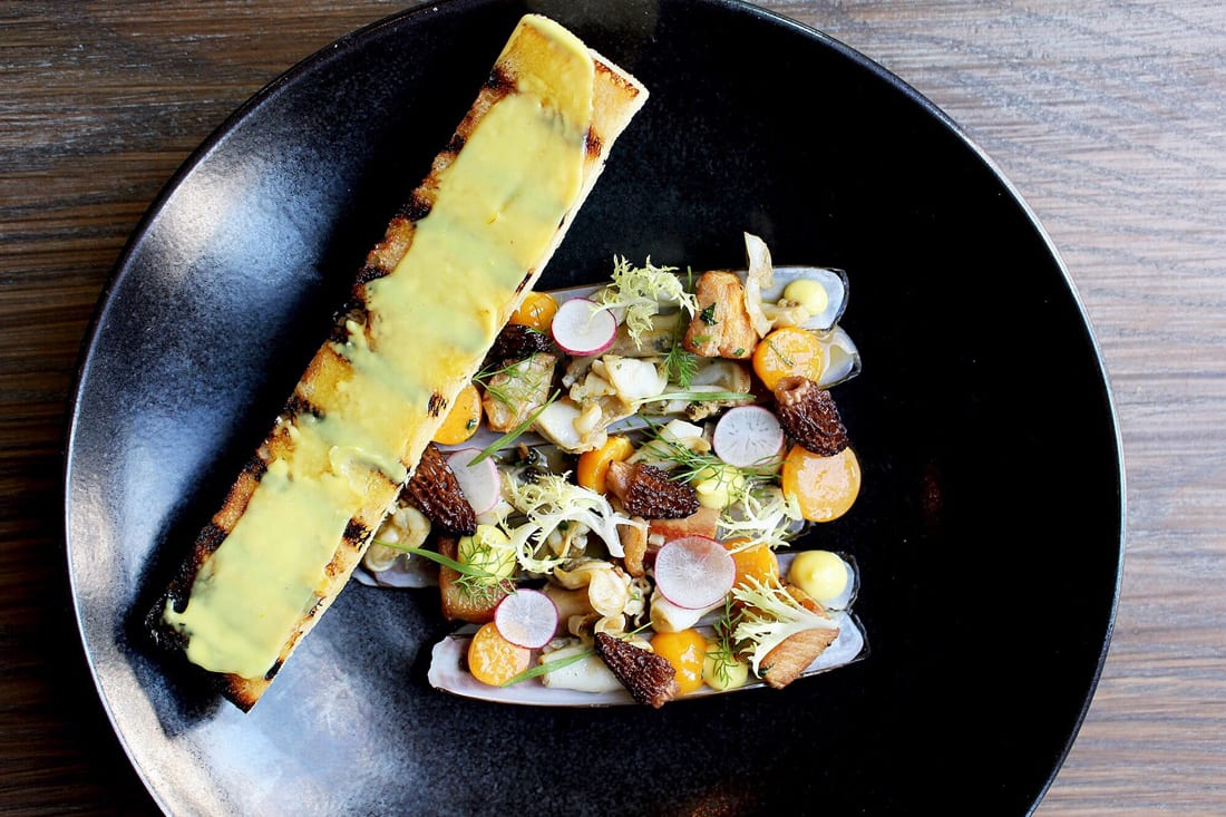 Watershed's Matt Marcus (left) serves up beautifully plated dishes such as these razor clams with morel mushrooms.