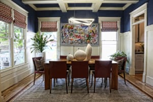 The dining room features a table from Cantoni and artwork by Cuban artist Luis Rodriguez NOA.