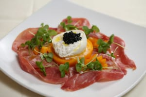 The cornerstones of Italian cuisine come together in the burrata di mozzarella fresca appetizer.