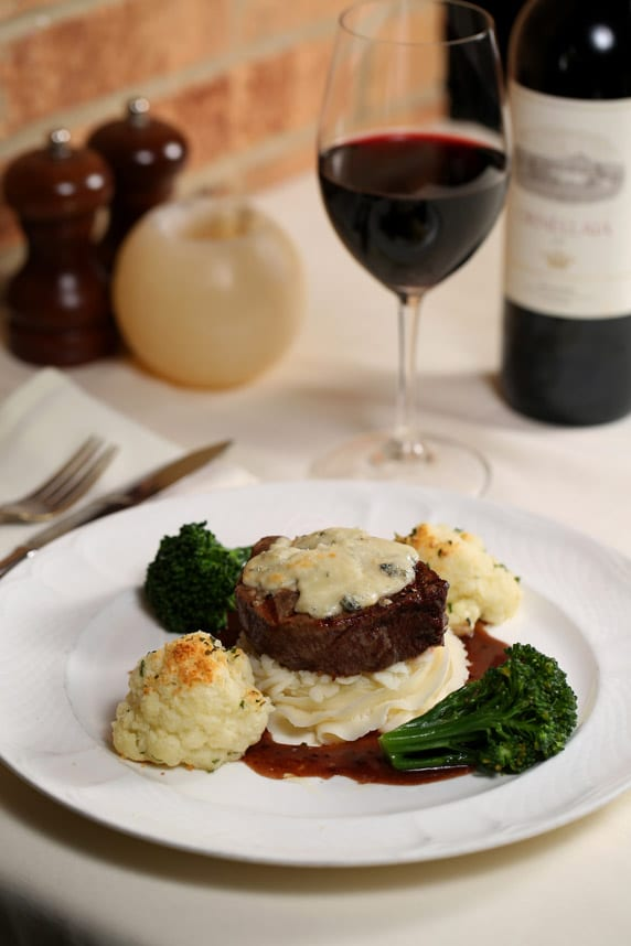 La Grotta's filetto di manzo al Barolo tenderloin, served in a Barolo-Pommery mustard sauce and topped with Gorgonzola, is a triumph of complementary flavors.