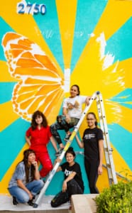 Yehimi Cambrón (top) and a team of artists painted a butterfly mural on the side of the LAA's offices.