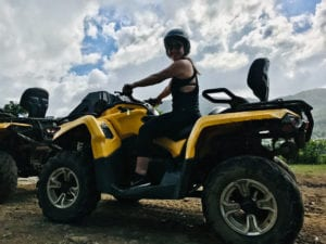 The author takes a trek on an ATV through the El Yunque National Forest, which is also viewable from the Yokahu Tower observation deck.