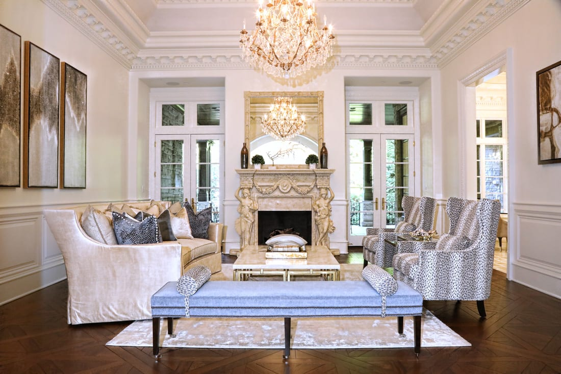The formal living room, once clad in gold moldings, features clean white walls and some sparkle.