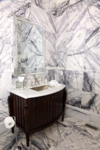 A main-level bathroom was designed to replicate the stylish men's restroom at the St. Regis Atlanta.