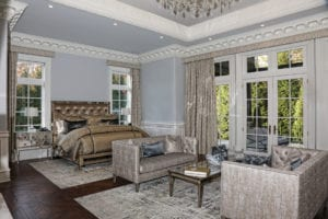 French doors open to the outdoors in the master bedroom.
