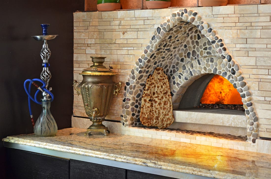 Focal point: Zafron's woodburning stone oven where pita is baked and served fresh throughout service.